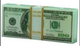 Свеча в виде пачки долларов